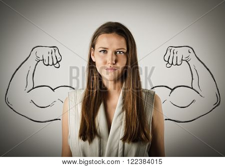 Pretty young woman with sketched strong and muscled arms. Young woman is doing something.