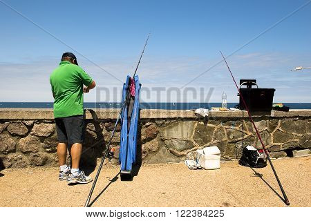 SAN SEBASTIAN, SPAIN JULY 12, 2015, a fisherman during a fishing competition, waterfront of Basque Country San Sebastian