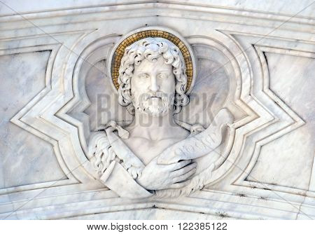 FLORENCE, ITALY - JUNE 05: St. John the Baptist relief on the facade of Basilica of Santa Croce (Basilica of the Holy Cross) - famous Franciscan church in Florence, Italy, on June 05, 2015