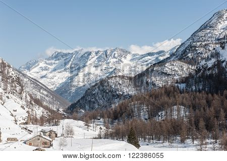 Alps mountain in winter with snow in a sunny day