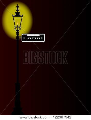 New Orleons street sign of Rue du Canal with old gas street light over a dark background
