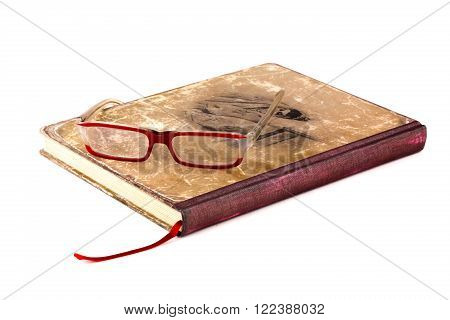 Red glasses on on the book with a bookmark