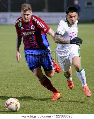 BUDAPEST HUNGARY - MARCH 19 2016: Duel between Martin Adam of Vasas (l) and Cristian Ramirez of Ferencvaros during Vasas - Ferencvaros OTP Bank League football match at Illovszky Stadium.