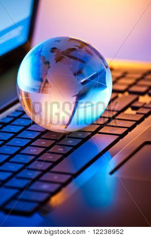 glass globe on a laptop keyboard
