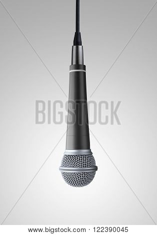 upside down hanging microphone on gray background