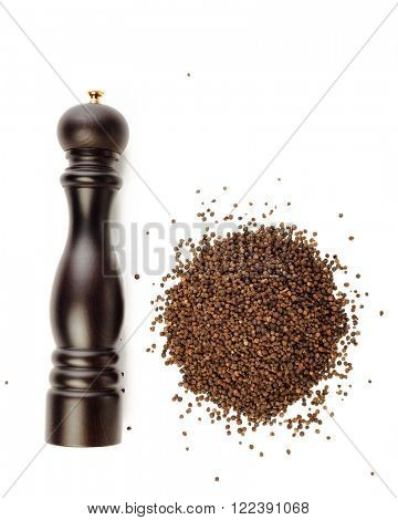 pepper mill and peppercorns heap, isolated on white