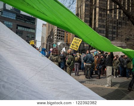 New York, NY, U.S.A. - March 20, 2016 - Documentary Editorial Image - Colored banners at a Trump protest in front of Trump International hotel and Tower in New York City