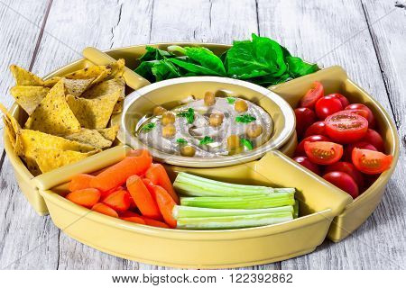 hummus with baby carrots celery sticks spinach