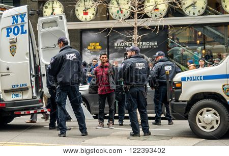 New York, NY, U.S.A. - March 20, 2016 - Documentary Editorial Image -  An anti-Trump protestor being arrested in New York City