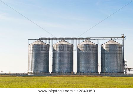 four farm grain silos for agriculture