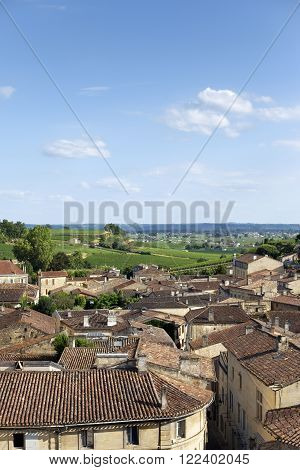 Panorama of Saint-Emilion village in France, vineyards on background