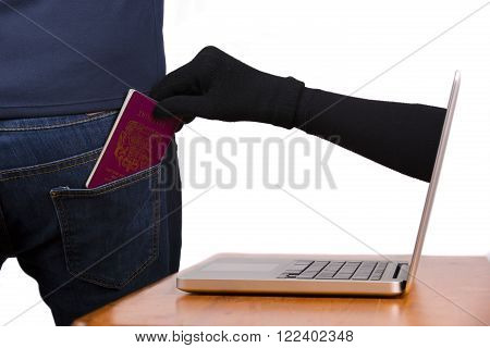 Internet theft - a gloved hand reaching through a laptop screen to steal a passport from a man.