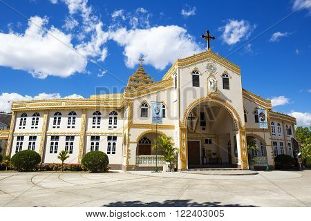 Christ the King Cathedral, Loikaw in Myanmar. Catholic Church. Blue sky with clouds.