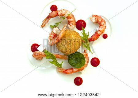 Risotto fritter prawns and tomato sauce on a plate