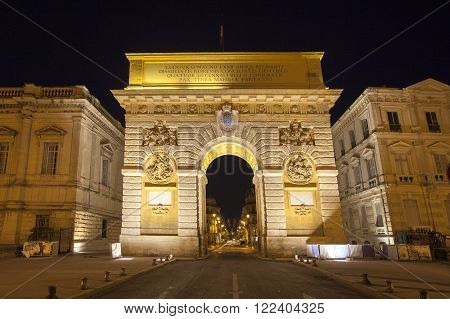 Arc de Triumphe in Montpellier, France. Illuminated at night.