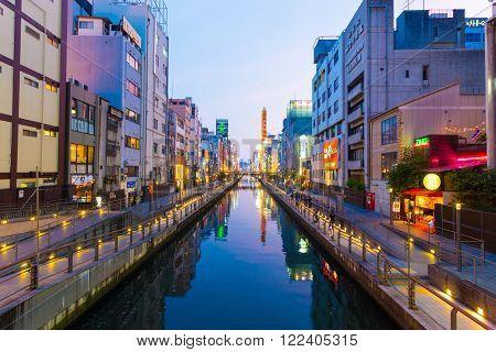 OSAKA, JAPAN - JUNE 23, 2015: Blue hour at historic Dotonbori canal  above Nipponbashi bridge at evening in Namba district of Osaka, Japan. Horizontal