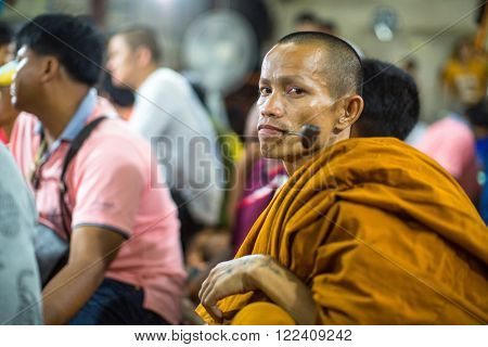 WAT BANG PHRA, THAILAND - MART 19, 2016: Unidentified monk master Yantra Tattoos at Bang Phra buddhist monastery, about 50 km west of Bangkok during Master Day Ceremony.