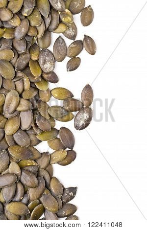 Unshelled pumpkin seeds border frame background over white background