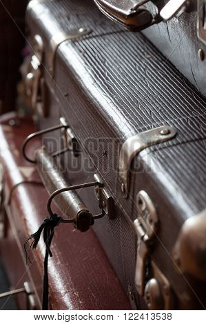 stack vintage leather suitcases closeup still life