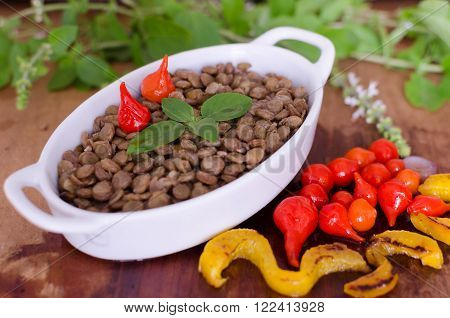 Lentils and colorful vegetables in a table wood