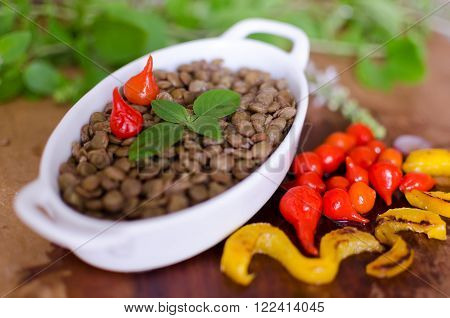 Lentils and colorful vegetables in wood table