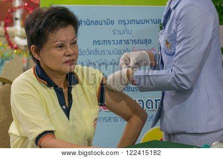 Bangkok, Thailand - December 4, 2015 : Unidentified Thai women get vaccinated against the flu every year by the Ministry of Health.