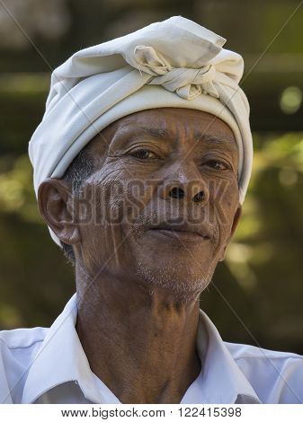 UBUD, INDONESIA - MARCH 18, 2015 : Portrait of unidentified man to Bali island. Inhabitants of Bali are kind and friendly even in old age