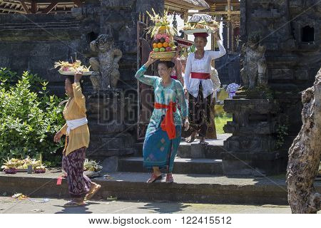 UBUD, BALI, INDONESIA - MARCH 19, 2015 : Unidentified Indonesian people celebrate Balinese New Year and the arrival of spring. Balinese women bring offerings of fruits and gifts to the village temple