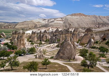 Cappadocia Turkey - April 29 2014: Valley Pasabag. The valley is known for its huge stone pillars a distinctive feature of Cappadocia. Tourists visiting the sights.