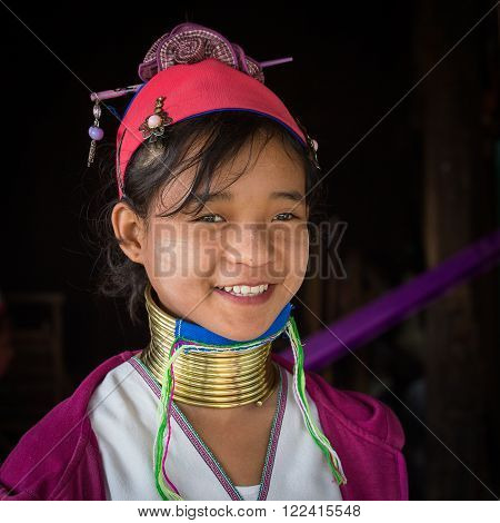 INLE LAKE, MYANMAR - JANUARY 12, 2016: Padaung Tribal woman poses for a photo in Inle lake, Myanmar, Burma The Padaung-Karen long-necked tribe women are minority of Myanmar.
