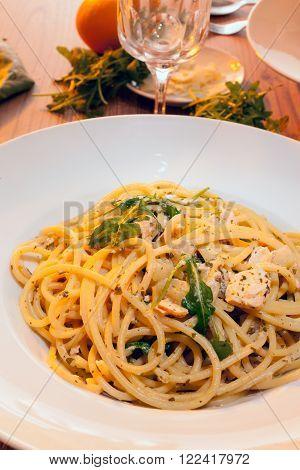 Italian pasta dish with salmon, turnip greens and Arugula