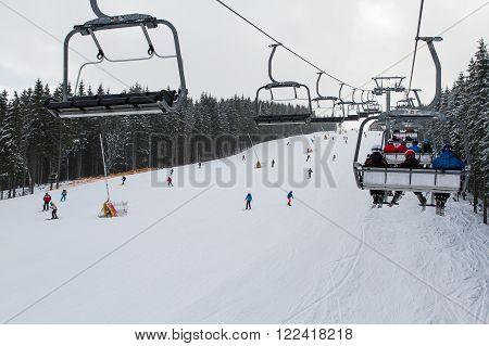 Bukovel, Ukraine - February 25, 2016:  Skiers and snowboarders enjoying on slopes of ski resort Bukovel, Ukraine.