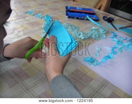 Little Boy Cutting A Paper