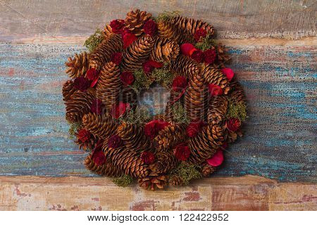 Christmas wreath with vintage patina wooden background
