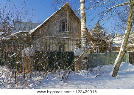 Old brick house in Moscow suburbs. Sunny winter day.