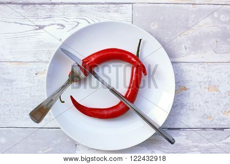Red Chilli Pepper On The Plate