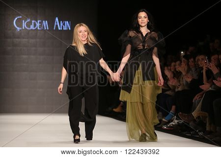 ISTANBUL, TURKEY - MARCH 16, 2016: Cigdem Akin greets the audience after her show in Mercedes-Benz Fashion Week Istanbul