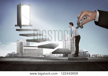 Hand Turns Clockwork On The Back Of Business Person