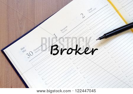 Broker text concept write on notebook with pen