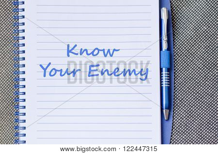 Know your enemy text concept write on notebook with pen