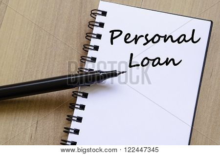 Personal loan text concept write on notebook with pen