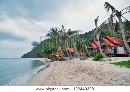 Cheap bungalows for backpackers on a tropical beach in evening time. Thailand