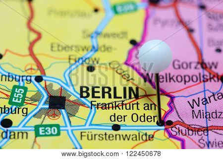 Photo of pinned Frankfurt an der Oder on a map of Germany. May be used as illustration for traveling theme.