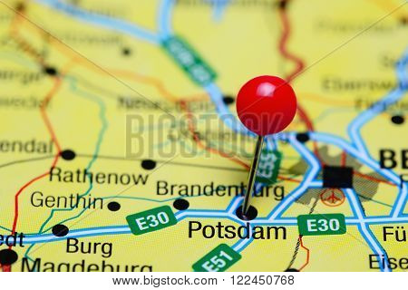 Photo of pinned Potsdam on a map of Germany. May be used as illustration for traveling theme.