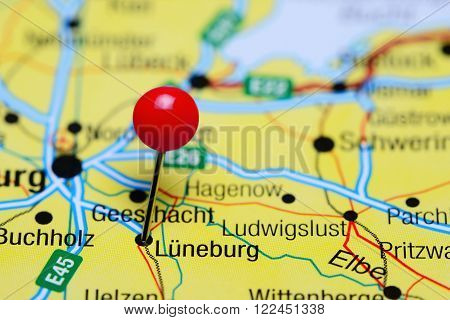 Photo of pinned Luneburg on a map of Germany. May be used as illustration for traveling theme.