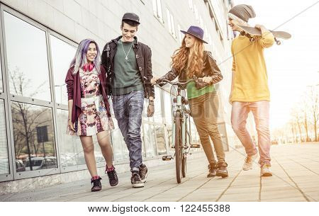 The crew. Group of teenagers walking in the city