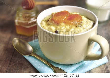 Oat Porridge With Honey, Raisins And Dried Apricots.