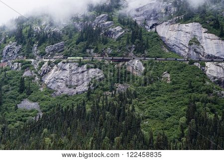 Alaska White Pass And Yukon Route Railroad Train Travelling Along Mountain Route