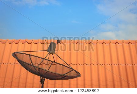 Satellite dish for communication technology on blue sky.
