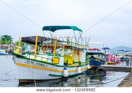 PARATY, RIO DE JANEIRO, BRAZIL - DEC 12, 2015: Boat at port of Paraty. Paraty is a colonial and historic city in Rio de Janeiro.